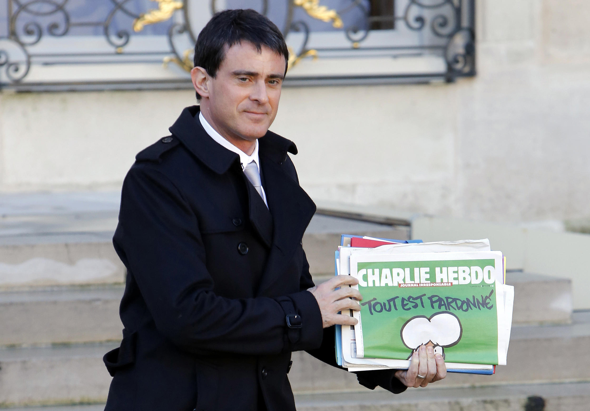 Manuel Valls, carrying the latest edition of Charlie Hebdo, 14 Jan, 2015