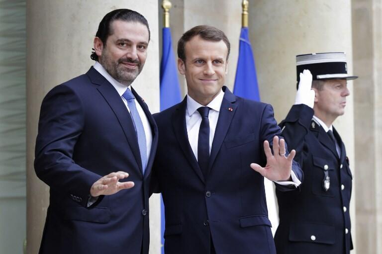 O presidente francês Emmanuel Macron (direita) e o primeiro-ministro demissionário libanês Saad Hariri (esquerda).