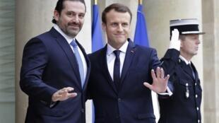 El presidente francés Emmanuel Macron y Saad al-Hariri en el palacio del Eliseo de París.