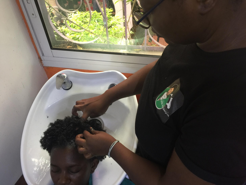 Hair dresser treating hair
