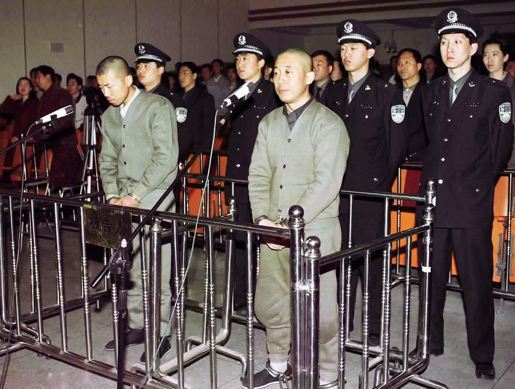 Falun Gong followers Dou Zhenxiang and Wang Hongjun during their trial at the Fushun Intermediate People's Court in Beijing, 29 April 2001. They were sentenced to 13 years in prison.