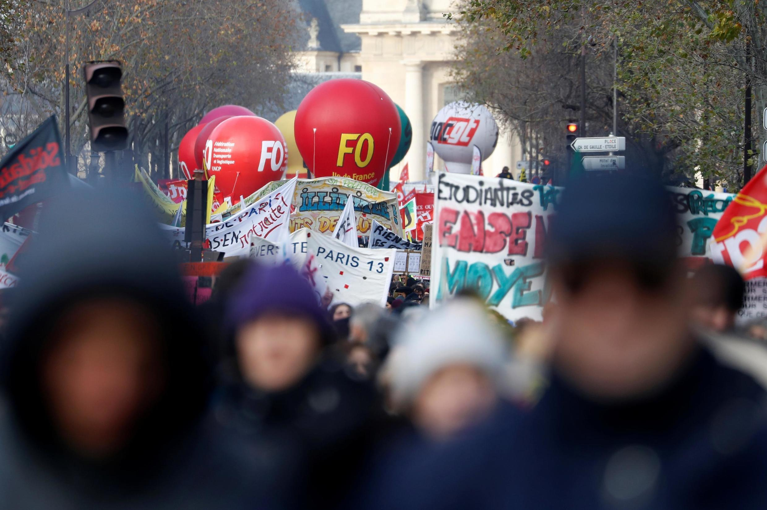 French labour union members attend a demonstration against French government's pensions reform plans in Paris as part of a second day of national strike and protests in France, December 10, 2019.