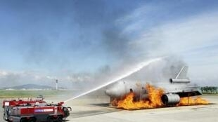Firefighters put out a fire during an anti-terrorism drill held at Incheon airport