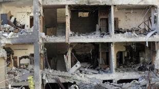 Prédio bombardeado pelo exercito sírio em Damasco.