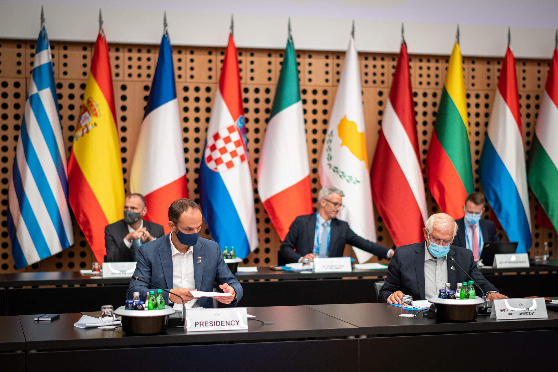 Slovenia's Foreign Minister Anze Logar (front-L) and European foreign policy chief Josep Borrell start an EU meeting in Slovenia's Brdo Castle