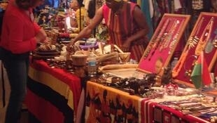 A curious onlooker eyes crafts and jewelry from Uganda, at UNESCO to celebrate Africa Week and Africa Day, Friday 25 May, 2018