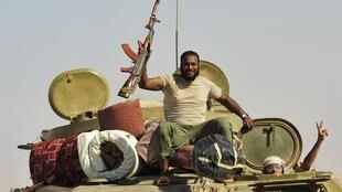 Libyan rebels on the way to Sirte