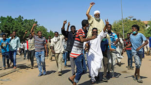 Sudanese demonstrators chant slogans near the home of a demonstrator who died of a gunshot wound sustained during anti-government protests in Khartoum, Sudan