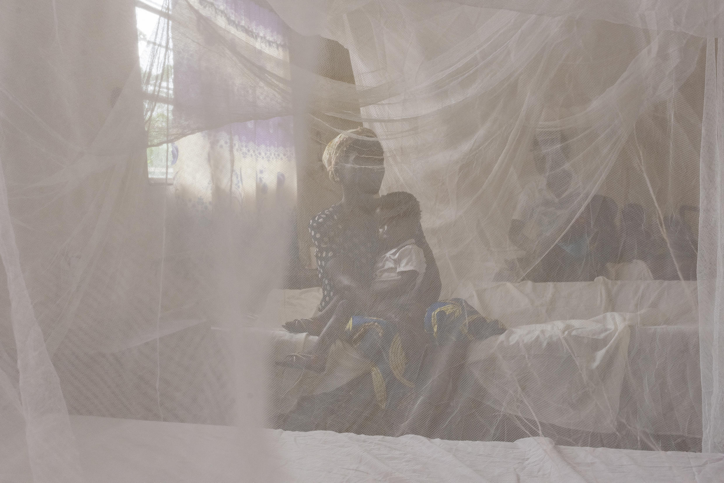 There is no vaccine against malaria, and the World Health Organization says sleeping under a mosquito net is the best protection
