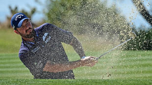 Defending champion Marc Leishman hits out of a bunker on the way to a one-under 71 in US PGA Tour Farmers Insurance Open that left him seven shots behind first-round co-leaders Patrick Reed and Alex Noren