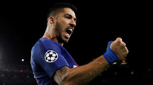 Luis Suarez scored Barcelona's fourth goal in an uneven display against Roma at the Camp Nou.