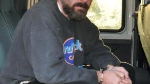 Yaakov « Jack » Teitel, dans un véhicule de la police lors de son arrestation le mois dernier.