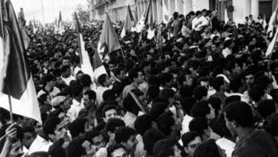 Crowds cheering Benyoucef Benkhedda, the premier of Algeria's provisional government, a day after independence from France, 6 July 1962.