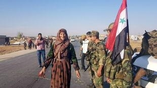 The Syria army arrives in Tal Tamer int he north-east of the country, October 14, 2019