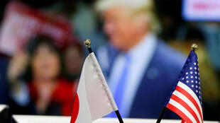 National flags of Japan and the U.S. are seen in front of a monitor displaying U.S. Republican presidential nominee Donald Trump on TV news at a foreign exchange trading company in Tokyo, Japan, November 8, 2016.