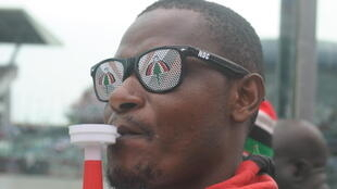 NDC supporter wearing sunglasses bearing the party's umbrella logo, Accra, 5 December 2016