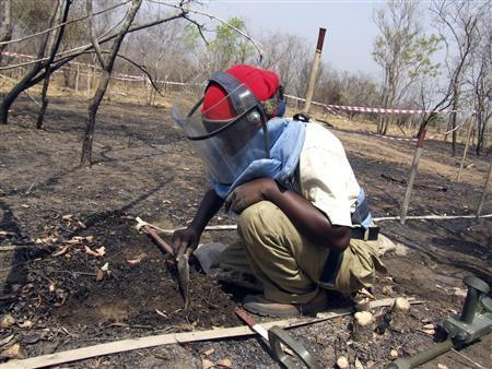 A deminer searches for mines in the earth near the southern capital Juba