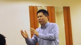 2013年3月30日,許志永在北京參加會議活動時發言。這是許志永失去自由前最後一張照片。