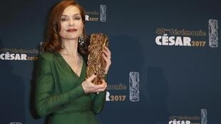 """Actress Isabelle Huppert holds her trophy during a photocall after receiving the Best Actress Award for her role in the film """"Elle"""" at the 42nd Cesar Awards ceremony in Paris, France, February 24, 2017."""