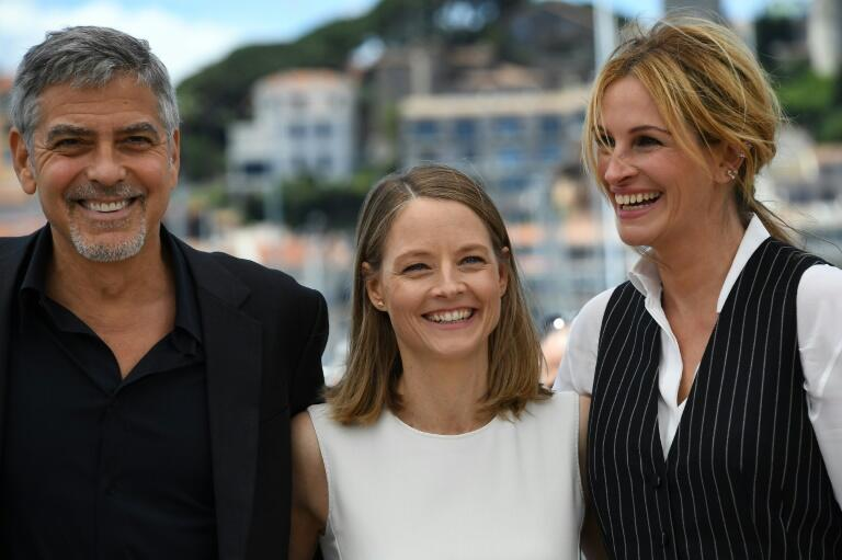 Jodie Foster (centre) beside Julia Roberts (R) and George Clooney (L) defending their film 'Money Monster' at the Cannes Film Festival, May, 2016.