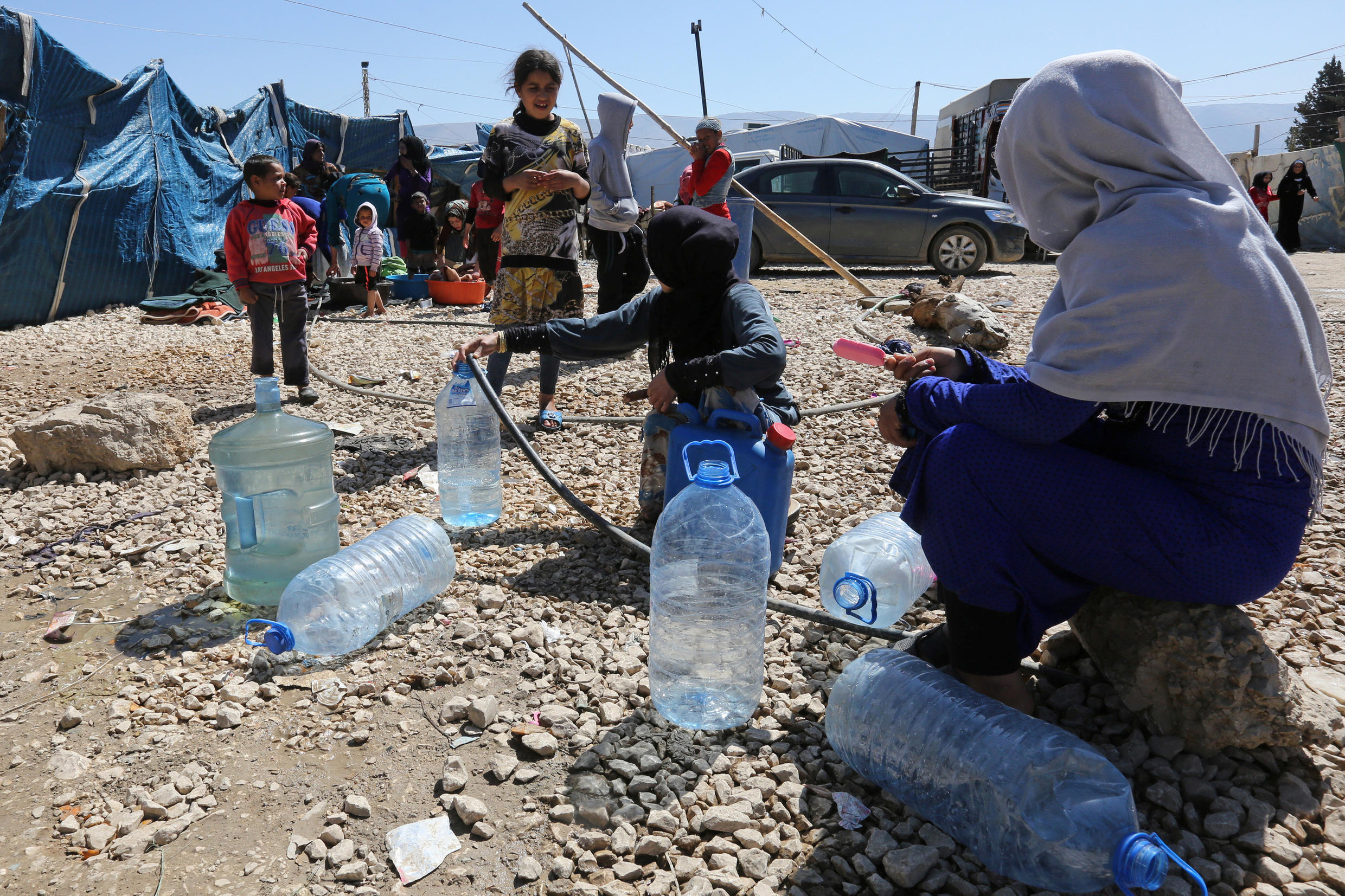 Syrian refugees at a makeshift settlement in Bar Elias town, in the Bekaa valley, Lebanon.