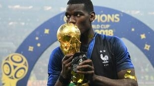 France's midfielder Paul Pogba celebrates with the World Cup trophy after the Russia 2018 World Cup final football match between France and Croatia at the Luzhniki Stadium in Moscow on July 15, 2018.