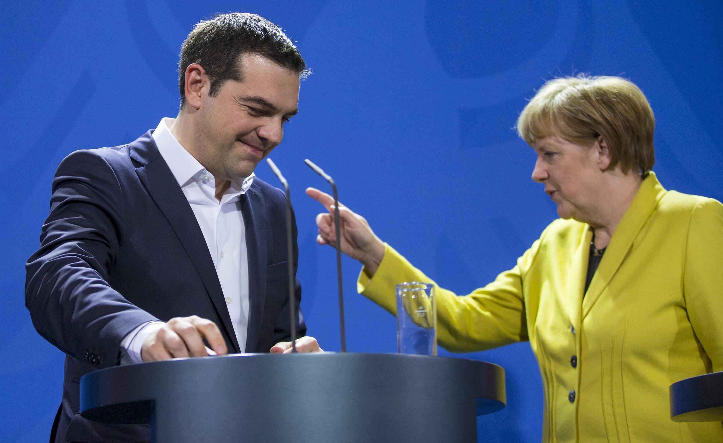 German Chancellor Angela Merkel and Greek Prime Minister Alexis Tsipras share a podium following talks at the Chancellery in Berlin March 23, 2015.