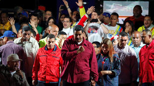 Venezuela's President Maduro stands with supporters after the results of the election were released in Caracas on 20 May 2018.