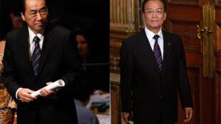 Le Premier ministre japonais Naoto Kan (g) et son homologue chinois (d) Wen Jiabao (d).