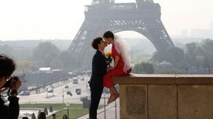 A couple kiss at the Trocadero overlooking the Tour Eiffel in Paris on April 30 2019.