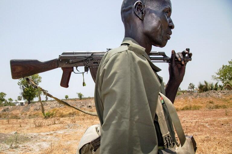 Member of the rebel SPLM-IO group walks near his base in Thonyor, Leer county on 11 April 2017.