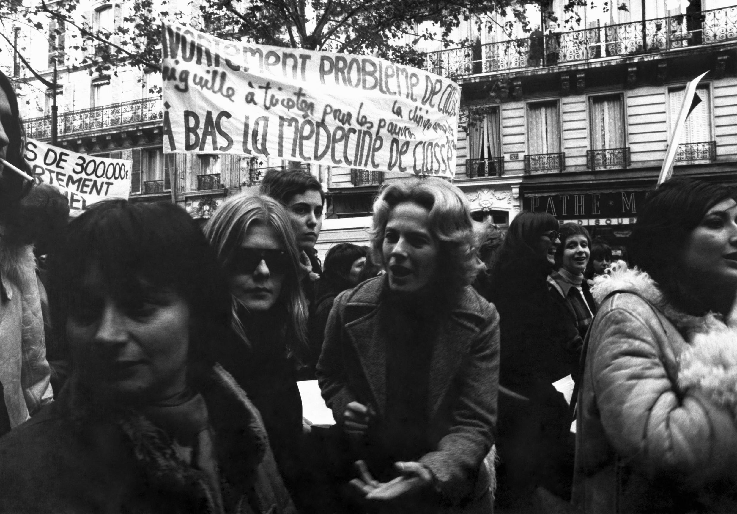 Actress Delphine Seyrig (3rd from left) and director Agnès Varda (L) at a feminist rally in Paris c. 1972