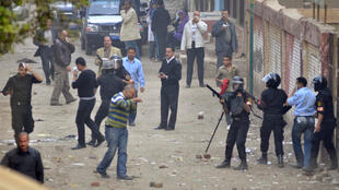 Security forces recover from clashes with Muslim Brotherhood supporters outside a polling station