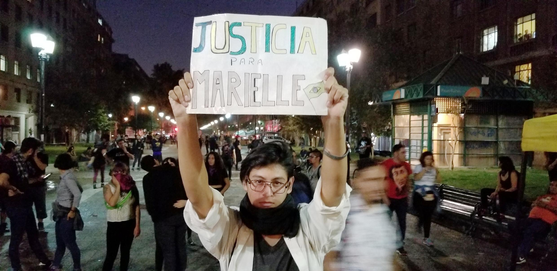 Manifestante David Carrasco aproveitou o protesto para pedir justiça pela morte da vereadora Marielle Franco.