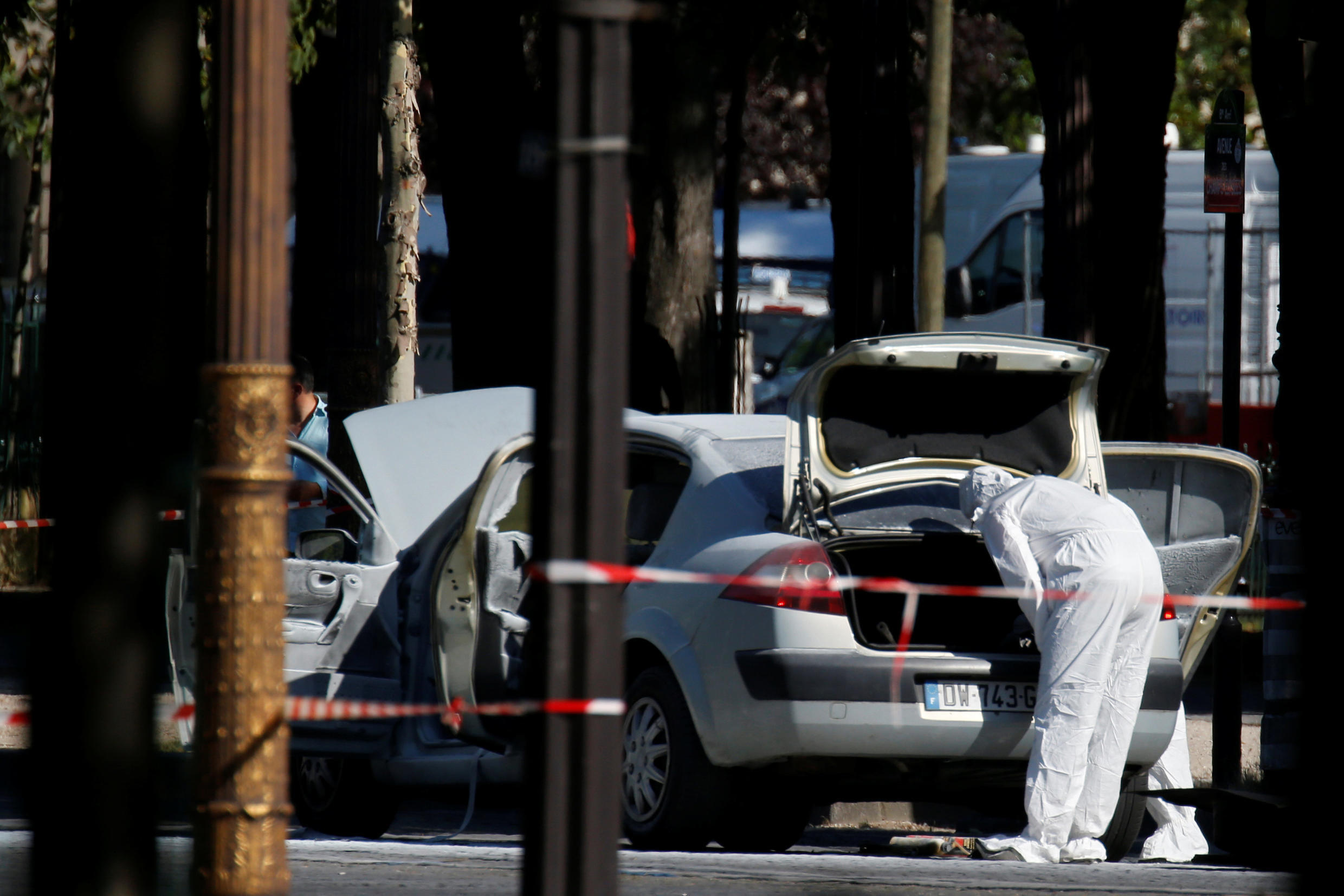 Forensic experts at the scene of the Champs-Elysées attack