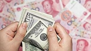 圖為美元與人民幣