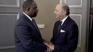 Senegal's President Macky Sall welcomes Laurent Fabius to Dakar on Saturday