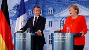 German Chancellor Angela Merkel and French President Emmanuel Macron attend a press conference after their meeting at the German government guesthouse Meseberg Palace in Meseberg, Germany on 19 June, 2018.