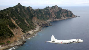 Japan Maritime Self-Defense Force's PC3 surveillance plane flies around the disputed islands in the East China Sea