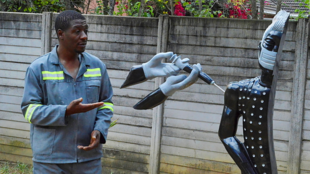 David Ngwerume's sculpture 'Arms' encourages vaccination against Covid-19.