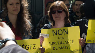 "Protestors against the law say ""Not to mass surveillance"" in April"