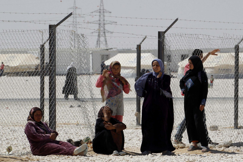 Des femmes syriennes réfugiées en Jordanie dans le camp al Zaatari, le 25 juin 2013.