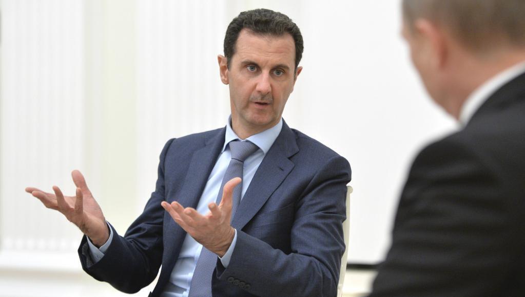 Bashar Al Assad, rais wa Syria, akizungumza na mwenzake wa Urusi Vladimir Putin wakati wa mkutano mjini Moscow tarehe 20 octobre.