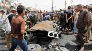 Bomu lilitegwa ndani ya gari ndogo na kulipuka katika mtaa unaokaliwa na Mashia wa Sadr City  mjini Baghdad, wakati wa soko Jumatano hii Mei 11, 2016.