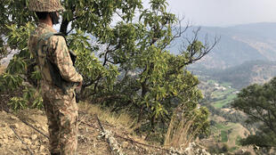 A Pakistani soldier stands guard at the Line of Control at Abdullah Pur village in Pakistani-controlled Kashmir