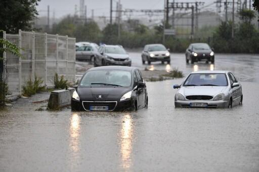 Vehicles are stuck while in flood water following overnight storms in Béziers, southern France on October 23, 2019.