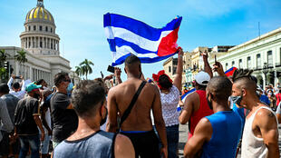 Cubans are seen outside Havana's Capitol during a demonstration against the government of Cuban President Miguel Diaz-Canel in Havana, on July 11, 2021