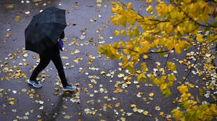 A person with an umbrella walks under the rain in Marseille, southern France on November 21, 2019.