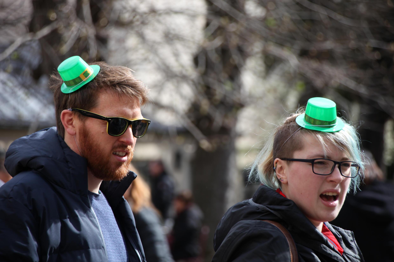 A couple wearing small leprechaun hats