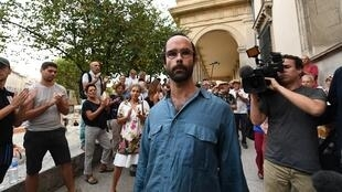 Cedric Herrou stands outside the court in Aix-en-Provence, France in August 2017.